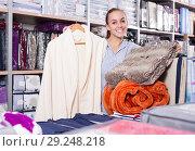 Купить «Woman customer buying multiple items in textile store», фото № 29248218, снято 13 ноября 2018 г. (c) Яков Филимонов / Фотобанк Лори