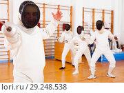 Купить «Sporty young man fencer practicing effective fencing techniques», фото № 29248538, снято 11 июля 2018 г. (c) Яков Филимонов / Фотобанк Лори