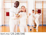 Купить «fencer practicing movements with african american trainer», фото № 29248546, снято 11 июля 2018 г. (c) Яков Филимонов / Фотобанк Лори