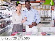 Купить «Couple standing in store of household appliances», фото № 29248590, снято 21 февраля 2018 г. (c) Яков Филимонов / Фотобанк Лори