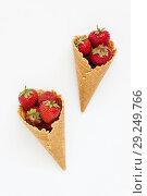 Купить «Waffle cone with fresh strawberries, top view, isolated on white», фото № 29249766, снято 18 июня 2017 г. (c) Tetiana Chugunova / Фотобанк Лори