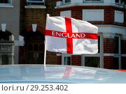 Купить «St George flag fixed to a car window as England prepare to play Belgium on Thursday in the FIFA World Cup. Their performance so far at the World Cup 2018...», фото № 29253402, снято 26 июня 2018 г. (c) age Fotostock / Фотобанк Лори
