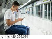 Купить «Passenger reading phone in subway», фото № 29256690, снято 24 августа 2018 г. (c) Яков Филимонов / Фотобанк Лори
