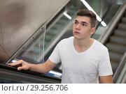 Купить «Man on subway station escalator», фото № 29256706, снято 24 августа 2018 г. (c) Яков Филимонов / Фотобанк Лори