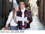 Купить «Smiling couple man and woman with map», фото № 29256858, снято 18 ноября 2017 г. (c) Яков Филимонов / Фотобанк Лори