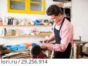Купить «Joiner working on machine», фото № 29256914, снято 8 апреля 2017 г. (c) Яков Филимонов / Фотобанк Лори