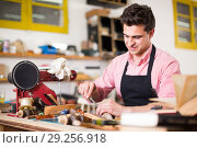 Купить «Joiner working in workshop», фото № 29256918, снято 8 апреля 2017 г. (c) Яков Филимонов / Фотобанк Лори