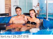 Купить «Couple relaxing in spa pool», фото № 29257018, снято 18 июля 2017 г. (c) Яков Филимонов / Фотобанк Лори