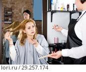 Купить «Young woman is not happy with her hair», фото № 29257174, снято 7 марта 2017 г. (c) Яков Филимонов / Фотобанк Лори
