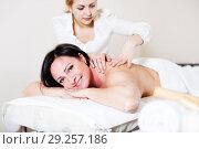 Купить «Adult woman very happy with procedure of massage», фото № 29257186, снято 7 марта 2017 г. (c) Яков Филимонов / Фотобанк Лори