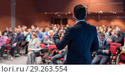 Купить «Public speaker giving talk at business event.», фото № 29263554, снято 2 марта 2020 г. (c) Matej Kastelic / Фотобанк Лори