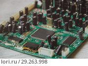 Купить «Printed Circuit Board with many electrical components», фото № 29263998, снято 25 сентября 2018 г. (c) Максим Бейков / Фотобанк Лори