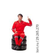 Купить «Young garage worker with tyre isolated on white», фото № 29265270, снято 21 июля 2018 г. (c) Elnur / Фотобанк Лори