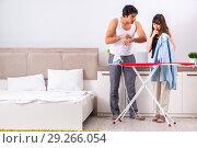 Купить «Young woman doing ironing for her husband», фото № 29266054, снято 27 июня 2018 г. (c) Elnur / Фотобанк Лори