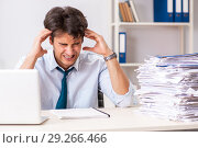 Купить «Overloaded busy employee with too much work and paperwork», фото № 29266466, снято 3 июля 2018 г. (c) Elnur / Фотобанк Лори