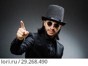 Купить «Vintage concept with man wearing black top hat», фото № 29268490, снято 1 июня 2015 г. (c) Elnur / Фотобанк Лори