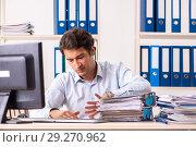 Купить «Overloaded busy employee with too much work and paperwork», фото № 29270962, снято 7 июля 2018 г. (c) Elnur / Фотобанк Лори