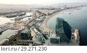 Купить «Panoramic view from drone of famous Barceloneta beach with hotel W Barcelona», видеоролик № 29271230, снято 26 августа 2018 г. (c) Яков Филимонов / Фотобанк Лори