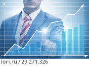 Купить «BUsinessman pressing virtual button on diagram chart», фото № 29271326, снято 3 августа 2020 г. (c) Elnur / Фотобанк Лори