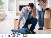 Купить «Woman evicting man from house during family conflict», фото № 29271826, снято 23 марта 2018 г. (c) Elnur / Фотобанк Лори