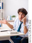 Купить «Overloaded busy employee with too much work and paperwork», фото № 29272662, снято 3 июля 2018 г. (c) Elnur / Фотобанк Лори