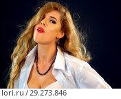 Купить «Woman eating berry. Pin up girl wearing unbuttoned blouse and bra.», фото № 29273846, снято 21 октября 2018 г. (c) Gennadiy Poznyakov / Фотобанк Лори
