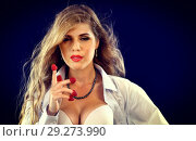 Купить «Woman eating berry. Pin up girl wearing unbuttoned blouse and bra.», фото № 29273990, снято 21 октября 2018 г. (c) Gennadiy Poznyakov / Фотобанк Лори