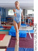 Купить «Happy beautiful woman gymnast training gymnastic action at broad bars», фото № 29274342, снято 18 июля 2018 г. (c) Яков Филимонов / Фотобанк Лори