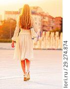 Купить «Fashion woman in autumn spring dress on city street and car.», фото № 29274874, снято 11 октября 2018 г. (c) Gennadiy Poznyakov / Фотобанк Лори