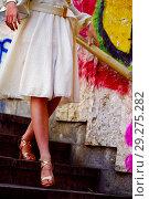 Купить «Fashion woman in autumn spring dress on city street.», фото № 29275282, снято 11 октября 2018 г. (c) Gennadiy Poznyakov / Фотобанк Лори