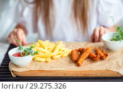 Купить «Close up Crispy Potato Fries on White Plate with Two Dipping Sauce, Served on Rustic Wooden Table», фото № 29275326, снято 20 августа 2018 г. (c) Дмитрий Травников / Фотобанк Лори
