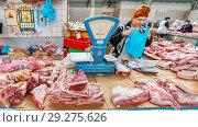 Купить «Russia, Samara, May 21, 2016: sale of fresh meat in the city's provincial market. Text in Russian: Tyumen. restroom.», фото № 29275626, снято 21 мая 2016 г. (c) Акиньшин Владимир / Фотобанк Лори