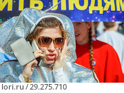 Купить «Russia, Samara, April 12, 2016: a young beautiful girl dressed with space theme, on holiday, Cosmonautics Day, in the square with a space rocket, on a spring sunny day.», фото № 29275710, снято 12 апреля 2016 г. (c) Акиньшин Владимир / Фотобанк Лори