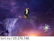 Купить «Мужчина бизнесмен с портфелем прыгает со скалы на рассвете к своей мечте», фото № 29276146, снято 19 февраля 2019 г. (c) Сергей Гавриличев / Фотобанк Лори