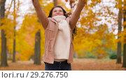 Купить «happy woman having fun with leaves in autumn park», видеоролик № 29276750, снято 18 октября 2018 г. (c) Syda Productions / Фотобанк Лори