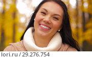 Купить «beautiful happy young woman smiling in autumn park», видеоролик № 29276754, снято 18 октября 2018 г. (c) Syda Productions / Фотобанк Лори