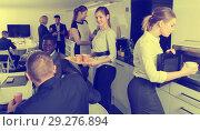 Купить «business people chatting while enjoying coffee», фото № 29276894, снято 10 марта 2018 г. (c) Яков Филимонов / Фотобанк Лори