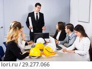 Купить «Team of discussing engineers», фото № 29277066, снято 7 декабря 2019 г. (c) Яков Филимонов / Фотобанк Лори