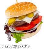 Купить «Image of burger with beef, tomato, cheese, cucumber and lettuce», фото № 29277318, снято 1 июня 2020 г. (c) Яков Филимонов / Фотобанк Лори