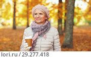 Купить «senior woman drinking coffee in autumn park», видеоролик № 29277418, снято 22 октября 2018 г. (c) Syda Productions / Фотобанк Лори