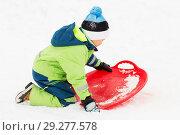 Купить «happy boy with snow saucer sled in winter», фото № 29277578, снято 10 февраля 2018 г. (c) Syda Productions / Фотобанк Лори