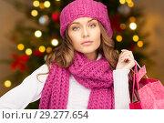 Купить «woman with shopping bags over christmas lights», фото № 29277654, снято 10 октября 2010 г. (c) Syda Productions / Фотобанк Лори