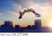Купить «man making parkour jumping over tokyo city», фото № 29277690, снято 25 августа 2015 г. (c) Syda Productions / Фотобанк Лори