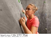 Купить «young woman exercising at indoor climbing gym», фото № 29277754, снято 2 марта 2017 г. (c) Syda Productions / Фотобанк Лори
