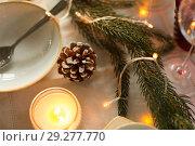 Купить «pine cone and candle burning on christmas table», фото № 29277770, снято 14 декабря 2017 г. (c) Syda Productions / Фотобанк Лори