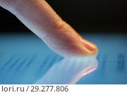 Купить «close up of hand using computer touch screen», фото № 29277806, снято 3 января 2018 г. (c) Syda Productions / Фотобанк Лори