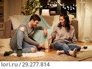 Купить «happy couple playing block-stacking game at home», фото № 29277814, снято 13 января 2018 г. (c) Syda Productions / Фотобанк Лори