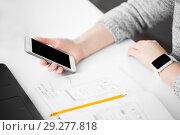 Купить «web designer creating mobile user interface», фото № 29277818, снято 17 января 2018 г. (c) Syda Productions / Фотобанк Лори