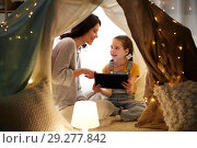 Купить «family with tablet pc in kids tent at home», фото № 29277842, снято 27 января 2018 г. (c) Syda Productions / Фотобанк Лори