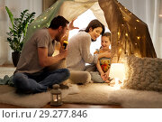 Купить «father telling scary stories to his daughter», фото № 29277846, снято 27 января 2018 г. (c) Syda Productions / Фотобанк Лори